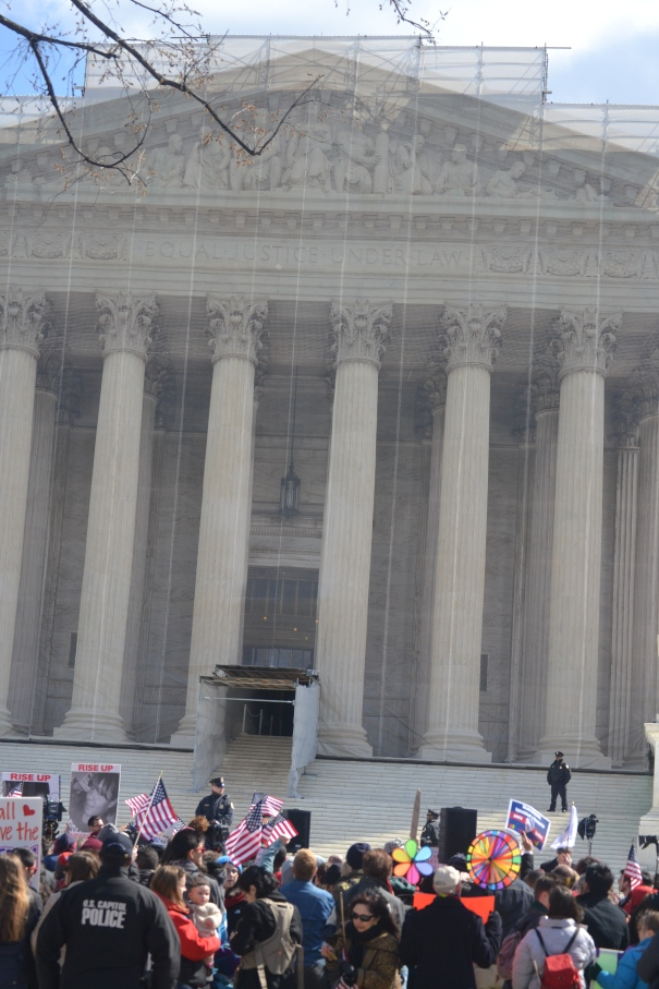 Lots of people in front of the Supreme Court (note that the building is being renovated so there is a false facade)